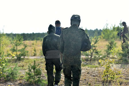 St. Petersburg, RUSSIA 19,08,2017 Open-air paintball tournament at the end of summer in nature, People in camouflage, with paintball guns and masks