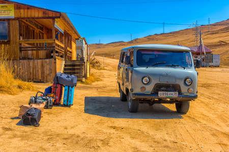 IRKUTSK, RUSSIA - 05,05 2018: Grey van, a common transportation which can run on sand, ice and rough road using on Olkhon island in Baikal lake, Irkutsk, Siberia, Russia