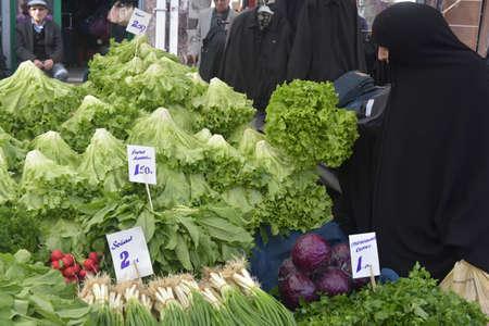 Turkey, Istanbul, 14,03,2018 Muslim woman buys greens in Istanbuls vegetable market