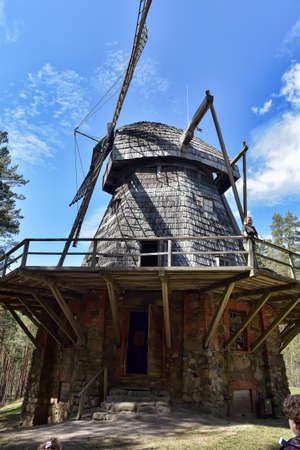Latvia, Riga, 01,05,2016 An old wooden mill in the Latvian Ethnographic Museum