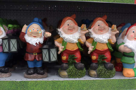 Russia, St. Petersburg, 01,09,2018 Garden ceramic dwarfs on the shelf in the supermarket Redakční