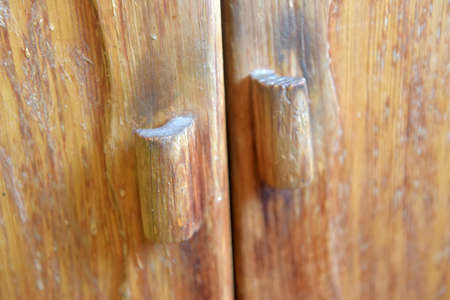 dirty old wooden cabinet handles 免版税图像