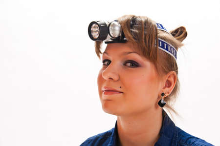 Young woman with headlamp on head
