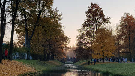 Russia, Pushkin, 14,10,2018 Autumn Park with an island and canals and people walking