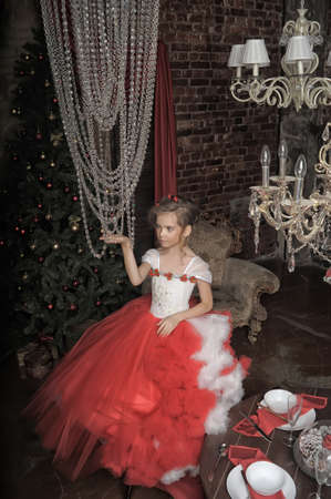 young princess in red with white dress and crystal chandelier 版權商用圖片