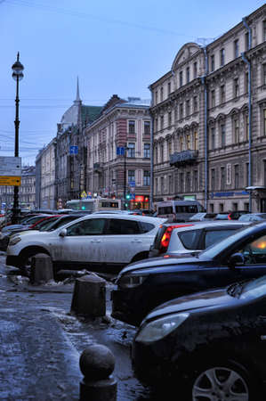 Russia, St. Petersburg, 03,03,2015 Cars parked on the street in the city center and pedestrians. Sajtókép