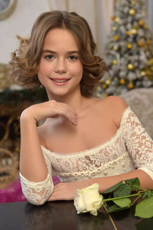 portrait of a beautiful 10 year old girl with a rose Archivio Fotografico