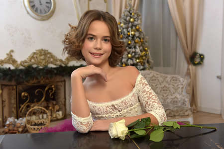 portrait of a beautiful 10 year old girl with a rose Stock fotó
