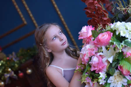 young blonde with curls and pink roses