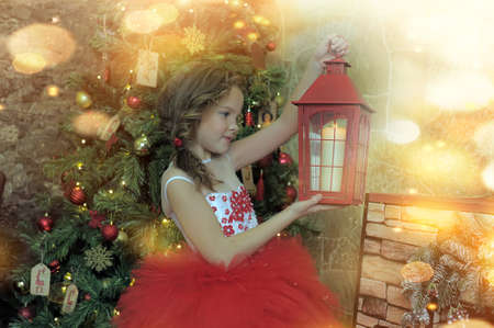 girl in a red dress with a flashlight. on Christmas