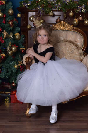 cute little girl with a crown on her head in christmas