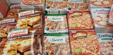 Russia, St. Petersburg 06.12,2018 Assorted of frozen foods display for sell in the supermarket. 新闻类图片