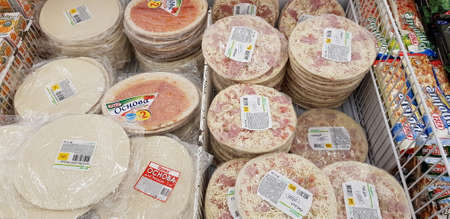 Russia, St. Petersburg 06.12,2018 Assorted of frozen foods display for sell in the supermarket. Banque d'images - 114034943