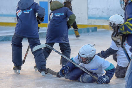 Russia, Severodvinsk 27,11,2016 Children with hockey sticks playing hockey at the festival