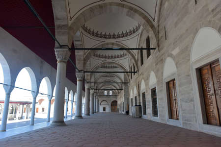 Turkey, Istanbul 14,03,2018 Mihrimah Sultan Mosque in Uskudar District. Muslims and tourists walk through the courtyard of the Mihrimah Mosque