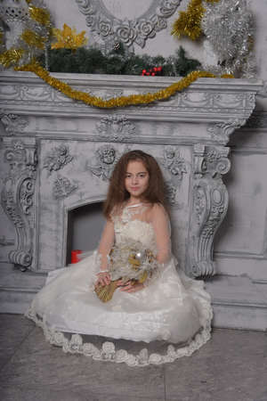 eastern type Beautiful little girl posing in white lace dress princess