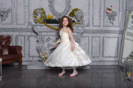a girl in a white dress whirls dancing in the hall