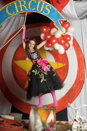 young actress in retro circus in the arena