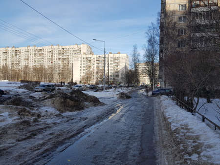 Russia, St. Petersburg 15,02,2019 Snowdrifts and ice along the sidewalk in a residential area