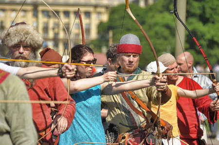 Russia, St. Petersburg 24,05,2014 People in medieval clothes shoot from a bow at the festival of historical reconstruction