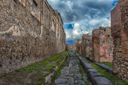 Italy, Pompeii 02,01,2018 Ruins of Pompeii near Naples, Italy. Pompeii is an ancient Roman city died from eruption of Vesuvius. Remains of Jupiter temple in Pompeii. Abandoned historical architecture in Pompeii