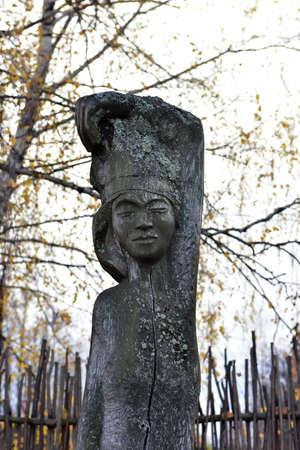 wooden idols on autumn background