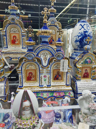 Russia, Moscow 04052019 Traditional Russian porcelain souvenirs Gzhel with religious themes