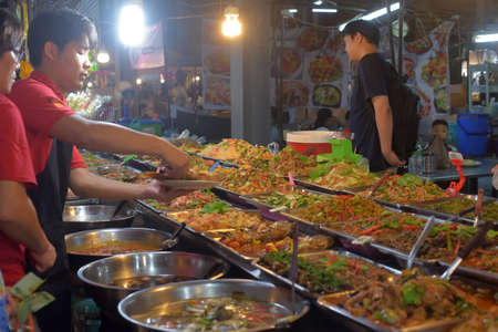 Thailand, Pattaya 24,08,2018 Visitors and sellers in the Thai night food market