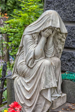 MOSCOW, RUSSIA - 08.07.2019 Vagankovskoye cemetery in Moscow. sculpture of a grieving woman on a grave
