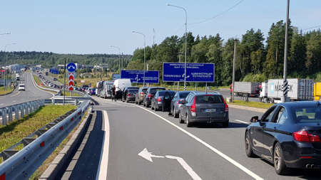 Russia, Torfyanovka 17,08,2019 A line of cars at a checkpoint on the border with Finland