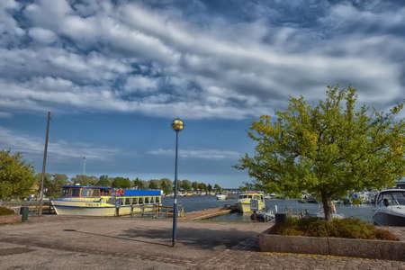 Finland, Kotka 17,08,2019 Tree on the Kotka embankment and yachts at the marina