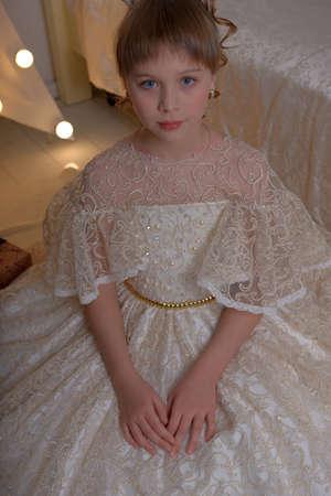 cute girl princess in alabaster dress