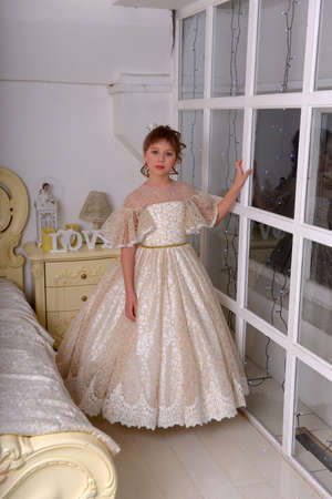 Cute Girl Princess In Alabaster Victorian Dress By The Window Archivio Fotografico