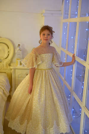 Cute Girl Princess In Alabaster Victorian Dress By The Window Reklamní fotografie