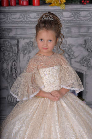 cute little girl in elegant white Victorian dress in the interior