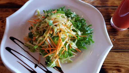 vitamin salad of carrots and cabbage on a plate Stock Photo