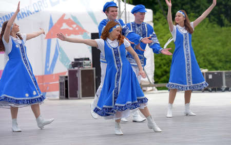 """Russia, St. Petersburg 25,05,2019 People in blue Russian national costumes dance at the International Festival """"Have Contact!"""" 報道画像"""