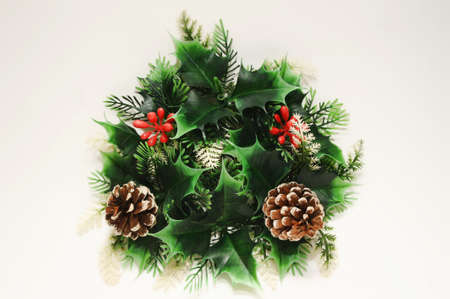 Christmas wreath with cones on a white background