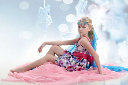 young blonde princess with a beautiful oriental decoration on her head with stones, fairy tale, elven princess