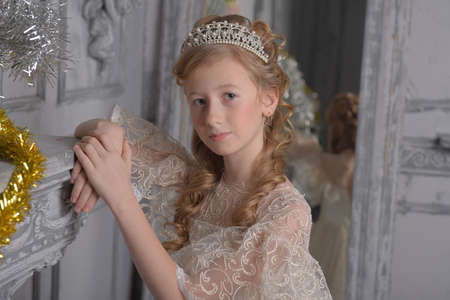 a girl in a lace white dress with a diadem in her hair, a young aristocrat, a ball gown