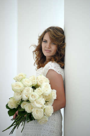 Portrait of happy woman with roses in hands Zdjęcie Seryjne