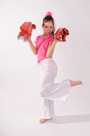 girl in pink in the studio with a huge candy in her hands