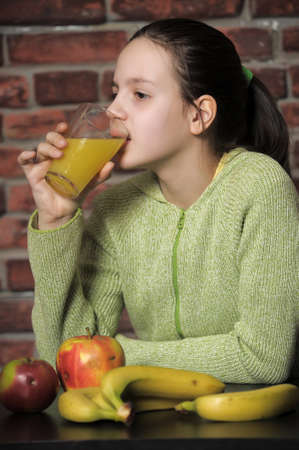 girl with orange juice and fruits, healthy eating
