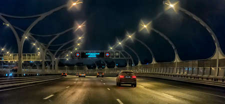 Russia, St. Petersburg 19,01,2020 Cars at night on a high-speed road