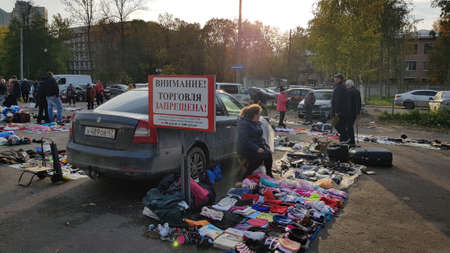 Russia, St. Petersburg 19.10,2019 Flea market and people trading on it Editorial