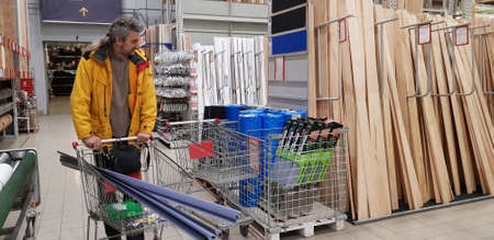 Russia, St. Petersburg 19.10,2019 A buyer with a trolley in a building goods store