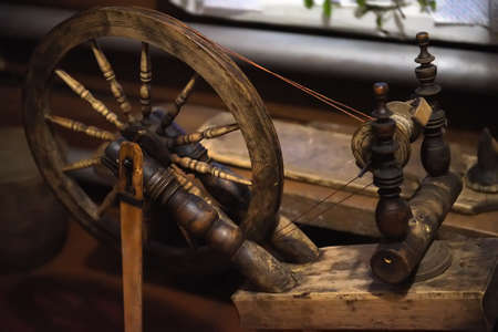 Spinning wheel spoke wheel spindle on wooden antique spinning machine