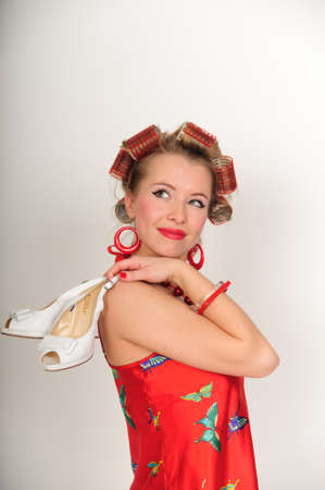 Girl in curlers with shoes, photo-style pin up