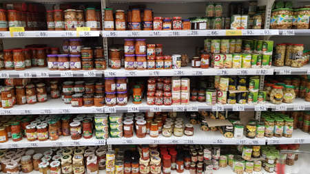 Russia, St. Petersburg 15.03.2020 Shelves with canned vegetables in a supermarket 新聞圖片