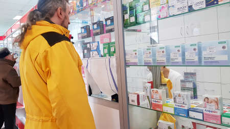 Russia, St. Petersburg 29.03.2020 People at the pharmacy during the coronavirus epidemic